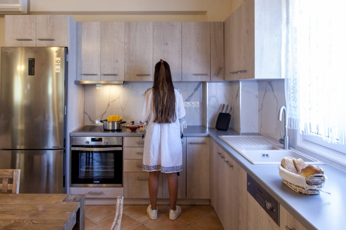 villa-petra-katouna-lefkada-girl-cooking-with-fully-equipped-kitchen